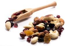 Close-up of pile of raw nuts and dried fruits in a wooden spoon stock image
