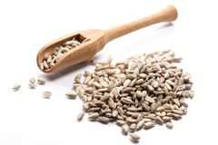 Close-up of pile of raw nuts, sunflower seeds in a wooden spoon stock images