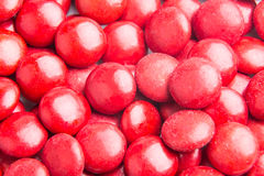 Close up on pile red milk chocolate candies crisp shell Stock Images