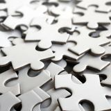 Close-up of a pile of uncompleted elements of a white puzzle. A huge number of rectangular pieces from one large white mosaic.  royalty free stock photo