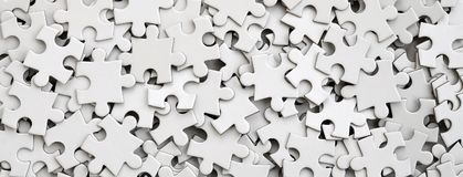 Close-up of a pile of uncompleted elements of a white puzzle. A huge number of rectangular pieces from one large white mosaic.  royalty free stock image