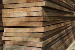 Close up pile wood texture stack in factory Stock Photos
