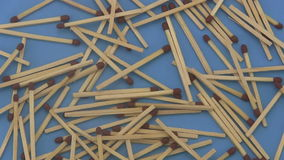 Close up of a pile of wooden matches rotating on a blue  background. stock video footage