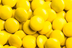 Close up on pile yellow milk chocolate candies crisp shell Royalty Free Stock Photo