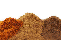 Close up of piles of various colourful spices Stock Images