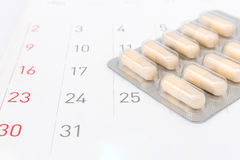Close up pill with date of calendar background, health care and. Medicine concept royalty free stock photos