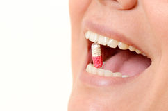 Close-up of pill in woman's mouth Royalty Free Stock Photo