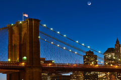 Close up of a pillar of the Brooklyn bridge with flag at night Royalty Free Stock Photos