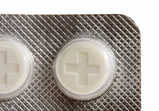 Close-up of pills marked by plus Royalty Free Stock Photo