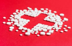 Close up of pills placed in the form of cross Royalty Free Stock Images