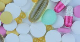 Close up with pills rotating. Pills and drugs. Variety of pills and tablets medicine on rotation