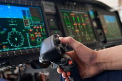 Close Up Pilot Holding Joystick In Helicopter Cockpit Stock Photography