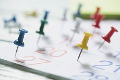 Close up of pin on calendar, planning for business meeting stock photography