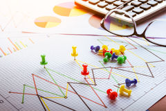 Close up of pin on graph data. Finance concept Stock Photo