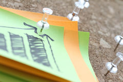 Close up of pin and hand drawn business strategy graph chart Stock Photography