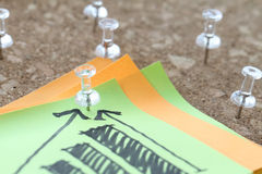 Close up of pin and hand drawn business strategy Stock Images