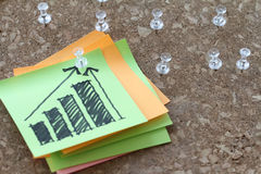 Close up of pin and hand drawn business strategy graph Royalty Free Stock Images