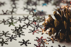 Close-up of pine cone and snowflake on wooden table Royalty Free Stock Image
