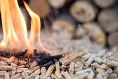 Pine pellets in fire. Close up of pine pellets in flames stock photography