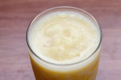 Pineapple smoothie on glass. Close up of pineapple smoothie on glass Stock Photos