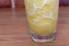 Pineapple smoothie on glass. Close up of pineapple smoothie on glass Stock Image