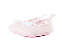 Close up pink baby shoes side view Stock Photos