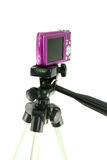 Close-up pink camera on a tripod. On a white background Royalty Free Stock Photography