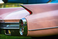 Close-up of pink car. Close-up of the rear of the pink vintage car. Back view of retro car. Vintage pink car. Detail of a vintage car. Selective focus Stock Images