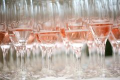 Close up of pink champagne glasses. On a table royalty free stock image