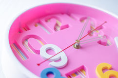 Close up pink clock. Royalty Free Stock Photography