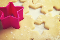 Close up of pink cookie cutter in dough Stock Images