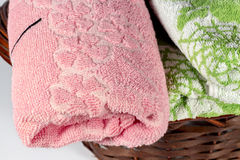 Close-up of pink hand towel into a wicker basket Stock Photo