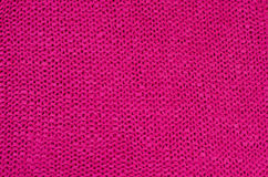 Close up on pink knit woolen texture. Stock Photo