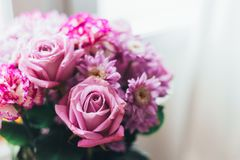 Close-up pink lilac bouquet, flowers - roses, gerberas royalty free stock photography