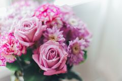 Close-up pink lilac bouquet, flowers - roses, gerberas stock photo