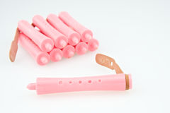 Close up pink plastic curler for hairstyle Royalty Free Stock Photography