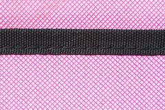Close-up pink soft case of tablet as background and texture, with black stripe Royalty Free Stock Image