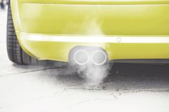 Close up on pipe exhaust car smoke emission Royalty Free Stock Photo