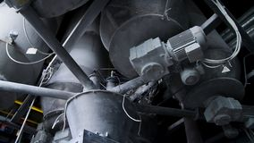 Close-up of pipelines and destillation tanks of an oil-refinery plant. Close up of steel pipes at modern beer factory. Brewery concept. Steel tanks for beer stock image