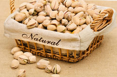 Close-up of pistachio nuts. In the basket Royalty Free Stock Photo
