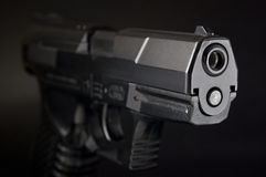 Close Up of pistol on black background Royalty Free Stock Photo