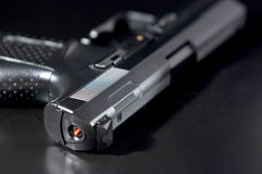 Close Up of pistol on black background Royalty Free Stock Photos