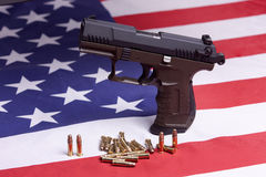 Close up of pistol on flag. Stock Photography
