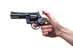 Close up of a pistol gun in the hand of a man. Isolated on white background Royalty Free Stock Photo