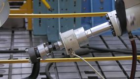 Close-up of piston of robotic machine is immitating a car trailer in movement ,bench tests