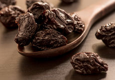 Close up of pitted prunes on black color wooden spoon. Close up of pitted prunes on black color wooden spoon royalty free stock photos