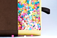 Close Up of pixel beads, plastic granules or plastic beads insid. E box Stock Photography