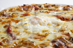 Close up of pizza with egg royalty free stock image