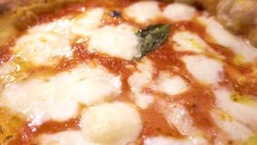 Close up of Pizza Margherita, italian food stock video