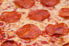 Close up of pizza with salami sausage Stock Photo
